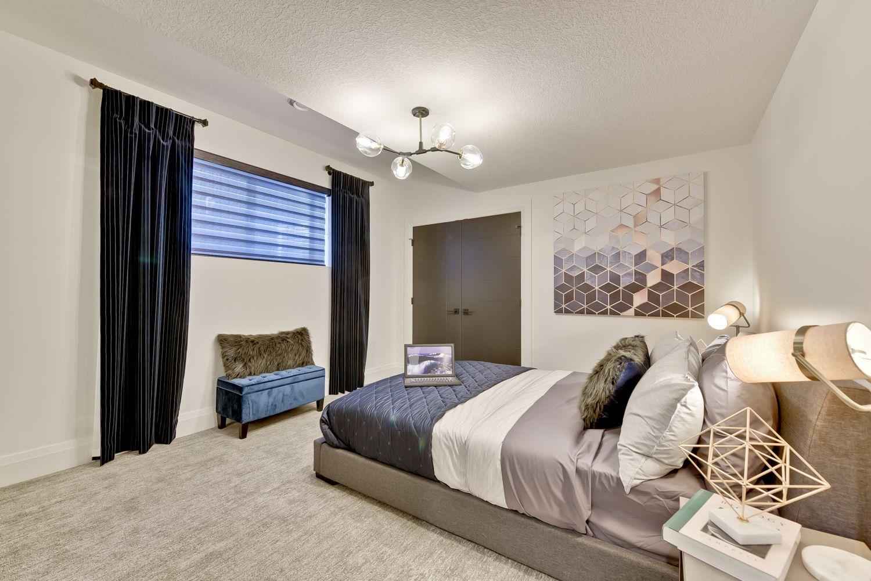 Beautiful Basement Bedroom with lots of lighting. Home