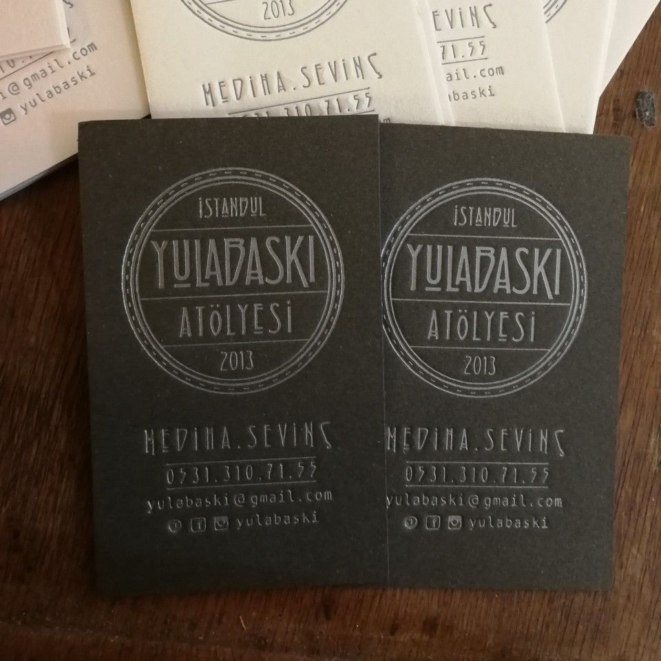 handmade letterpress business card silver ink on brown