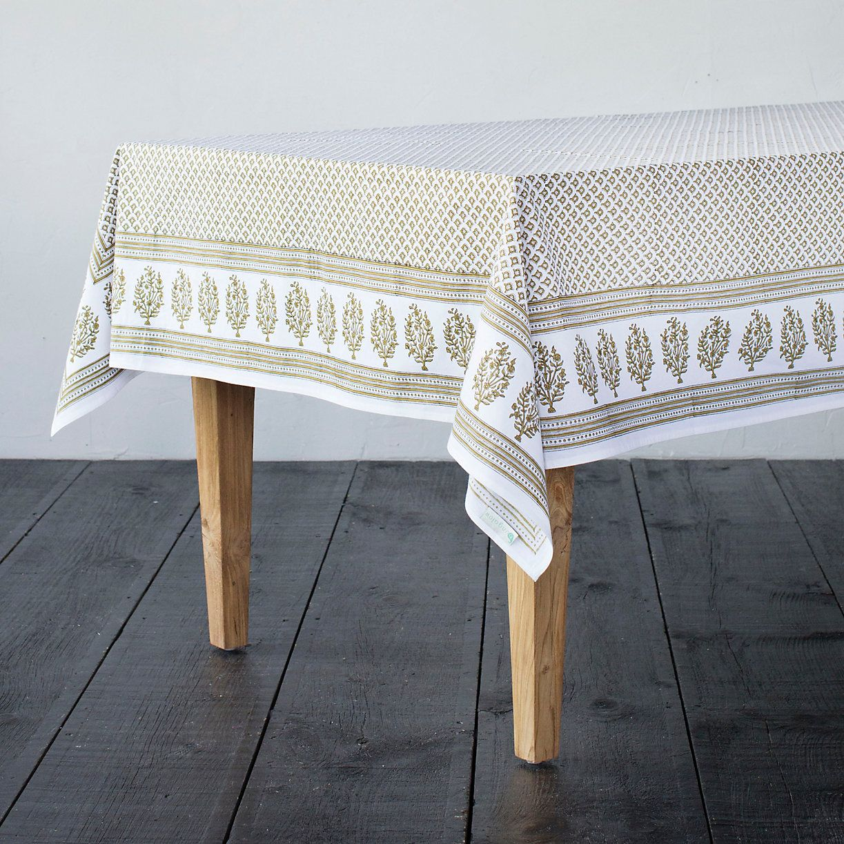 Block printed by hand using traditional methods, this cotton tablecloth brings a bold pattern to the dining room.- Cotton- Machine wash cold separatel
