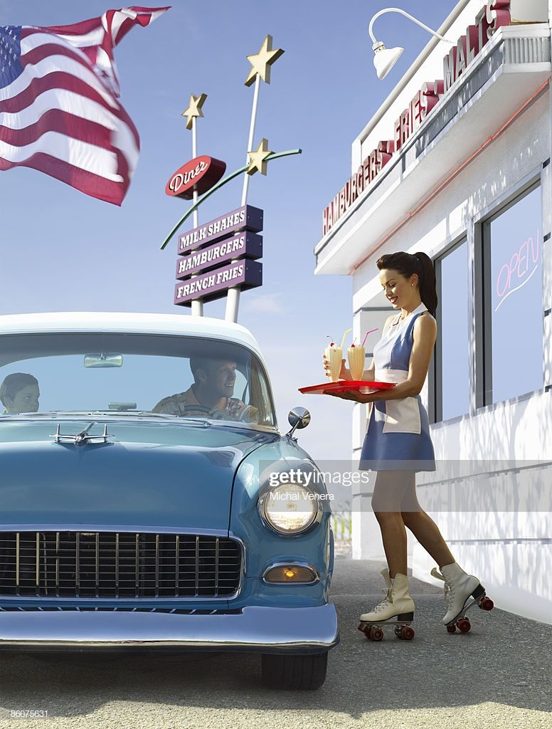 Vintage car and carhop at retro diner