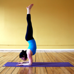 8 yoga poses to strengthen your way to a handstand