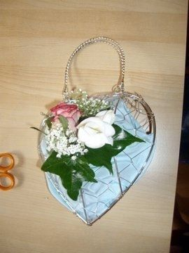 My Bridesmaids heart bag with satin lining and fresh flower corsage attached to the front