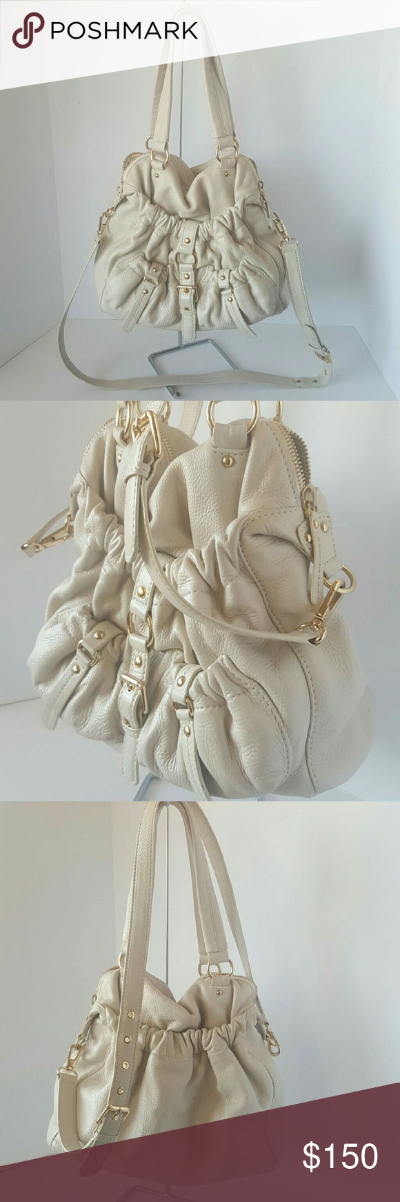 """Michael Kors Bag Purse Beautiful authentic bone vanilla leather MK Michael Kors Tote or shoulder bag. Gold tone hardware. Beige monogrammed soft fabric interior fully lined in genuine leather. Lots of compartment pockets. Pre-owned, has a few scuffs and light dirt marks from use. Can be professionally cleaned if you want it perfect! Tote Strap drop: 9""""  removeable adjustable strap is up to 22"""" long.  Fast ship!! Michael Kors Bags Shoulder Bags"""