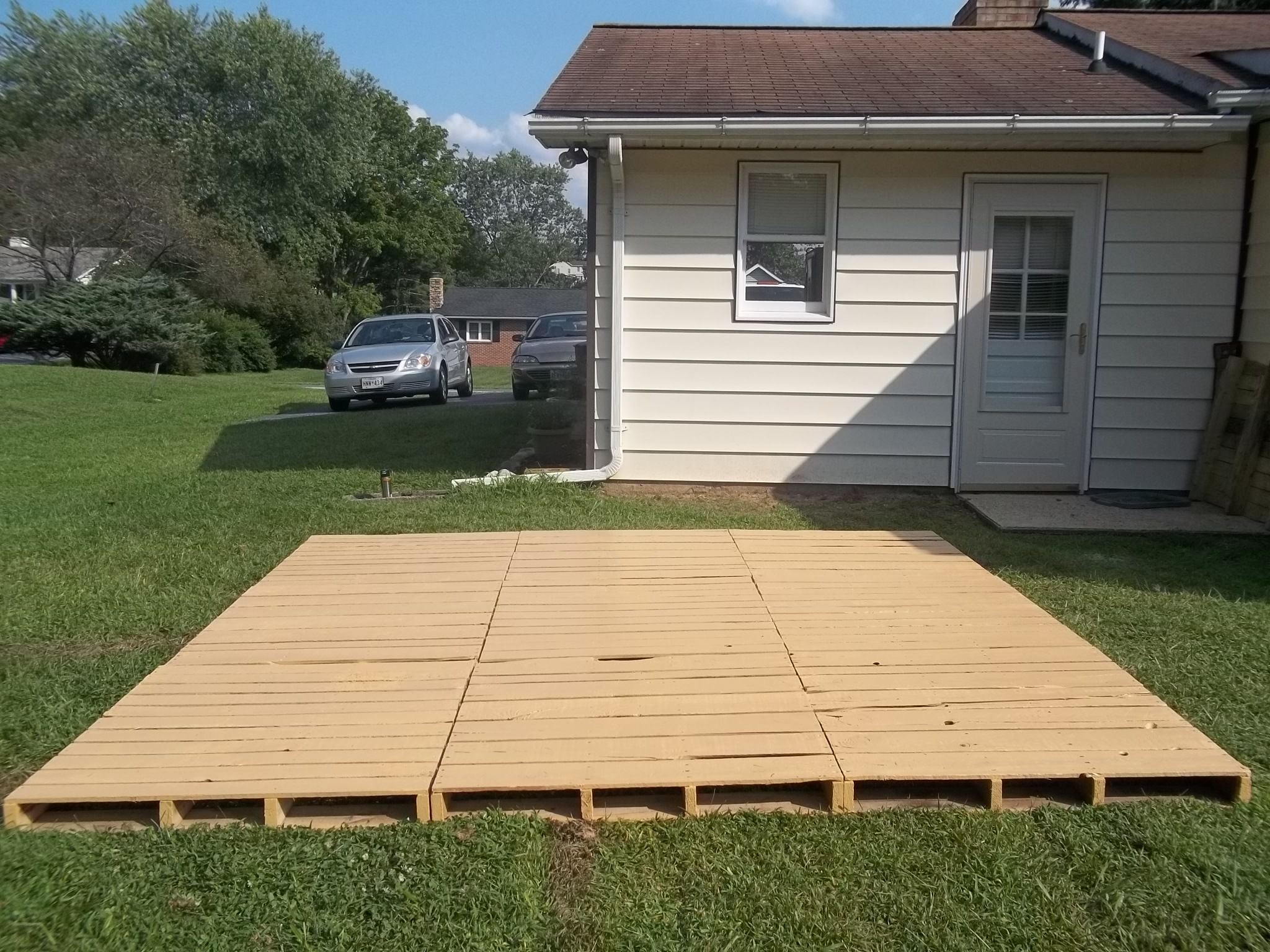 Pallet decks and patios this entry was posted in diy by for Outside decking material