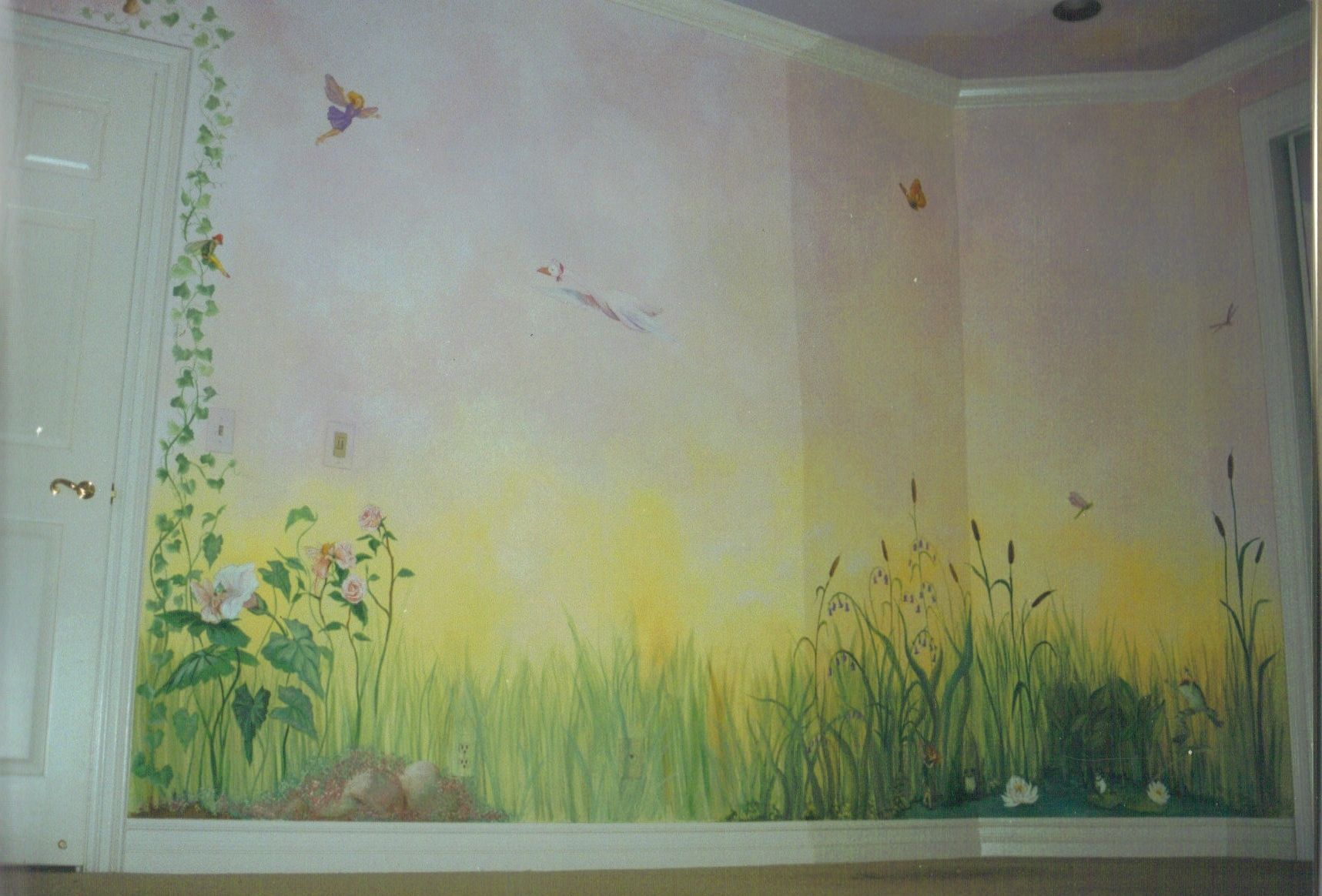 mural field and fairies in child's bedroom