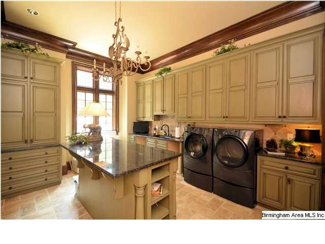 Extra Large Laundry Room With Lots Of Cabinets And Center Island