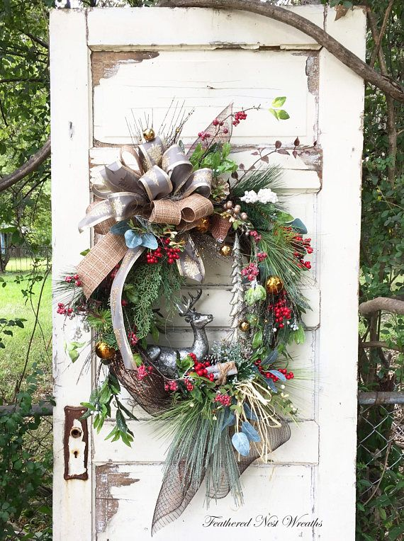 This Beautiful Woodland Christmas Wreath was Created on a Grapevine Base. I have Layered it with Red Berries, Icy Look White Berries, Cream Berries with Boxwood, Icy Twigs with Red Berries, Juniper and Long Needle Pine and Bronze Sparkly Pine with Bronze Ornaments. I Added a Pewter Colored Deer and Silver Sparkly Trees. The Wreath is Finished out with a Champagne Wired Ribbon with a Glittered Christmas Tree Design and a Tweed Look Wired Ribbon. This Wreath is just so Pretty and Elegant yet…