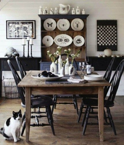 Here is a great view of a farmhouse dining room that we adore. I love the black & white theme they have incorporated into the look. True farmhouse style!