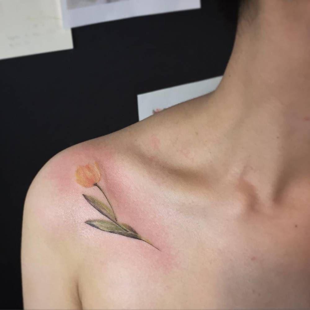 17e247dcb1f28 Yellow tulip tattoo on the shoulder. Tattoo artist: Muha Lee ...