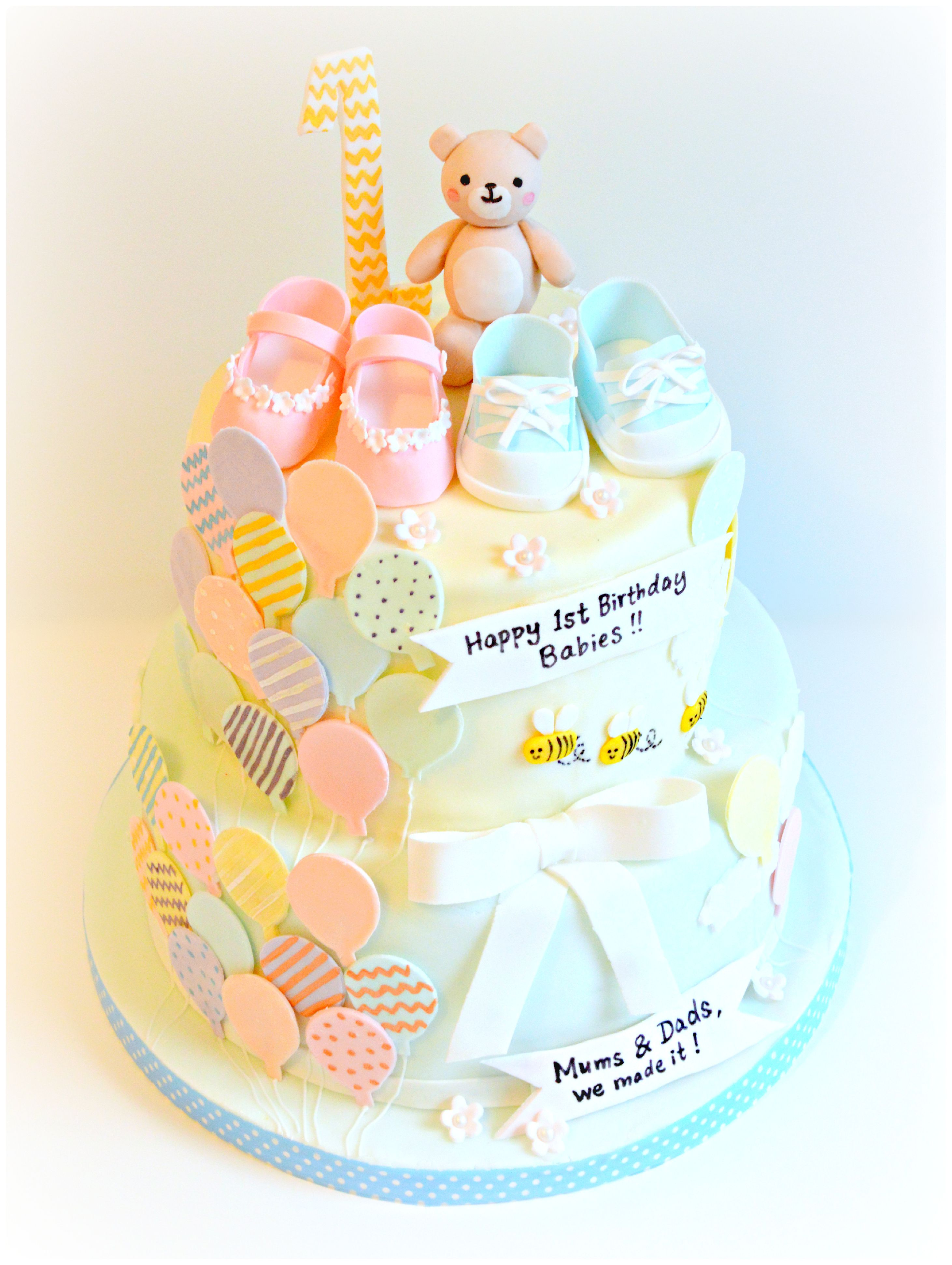Baby Boys And Girls One Year Old Birthday Cake With Baby Shoes And