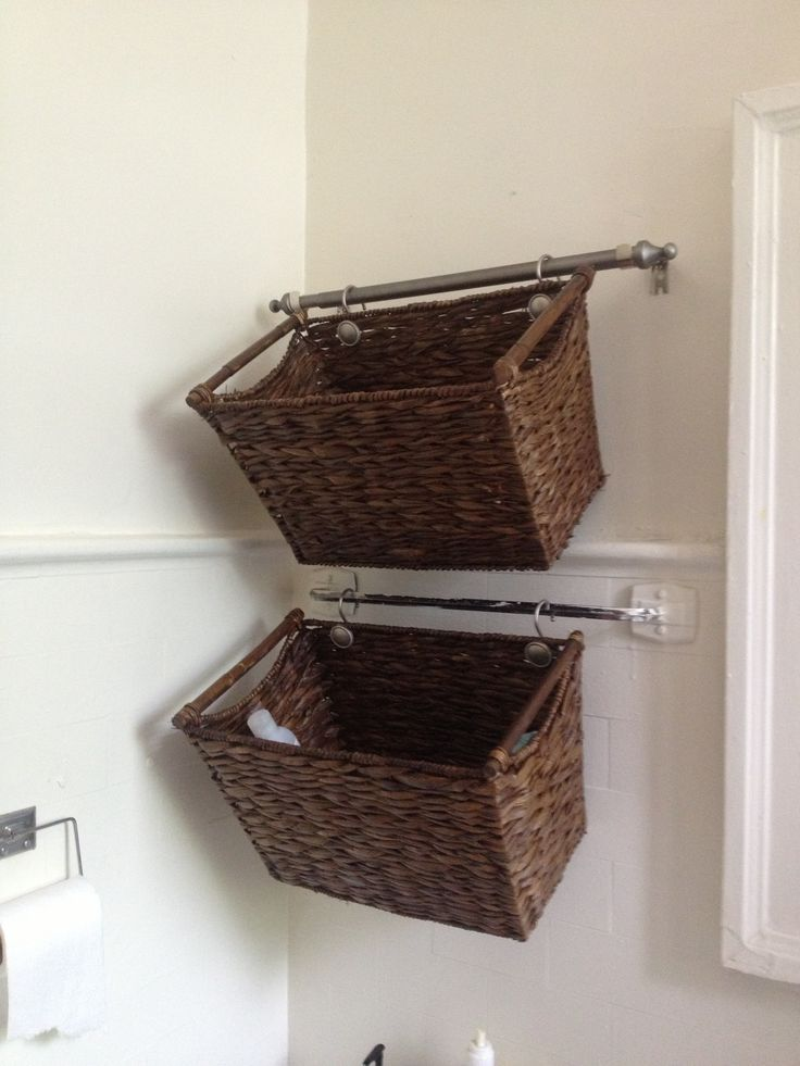 Using Shower Hooks To Hang Decorative Baskets From The Towel Racks Ingenious Bathroom Basket Storage Wall Basket Storage Bathroom Baskets