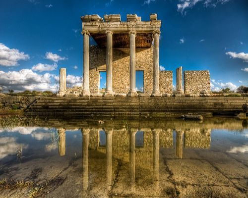 The ruins of Miletus are located on the western coast of Anatolia, near the mouth of the Maeander River in ancient Caria (near the modern town of Balat in Aydin Province, Turkey).
