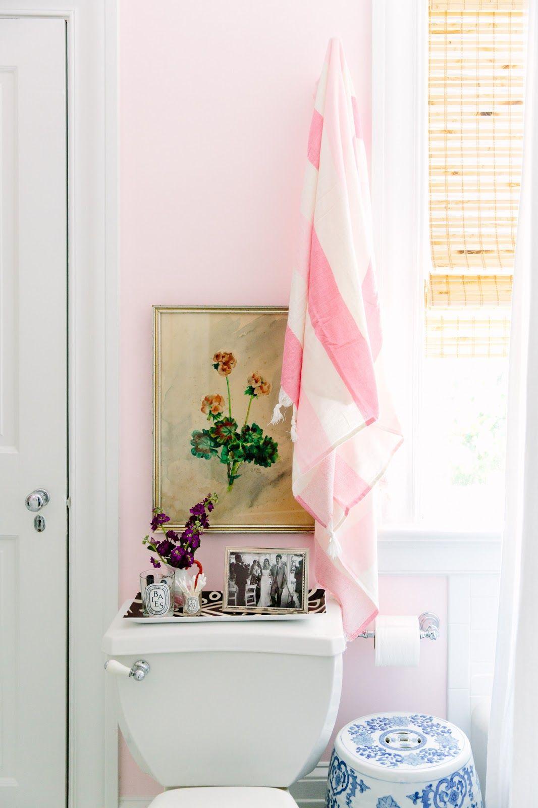 baby blush pink bathroom color vintage art above the toilet