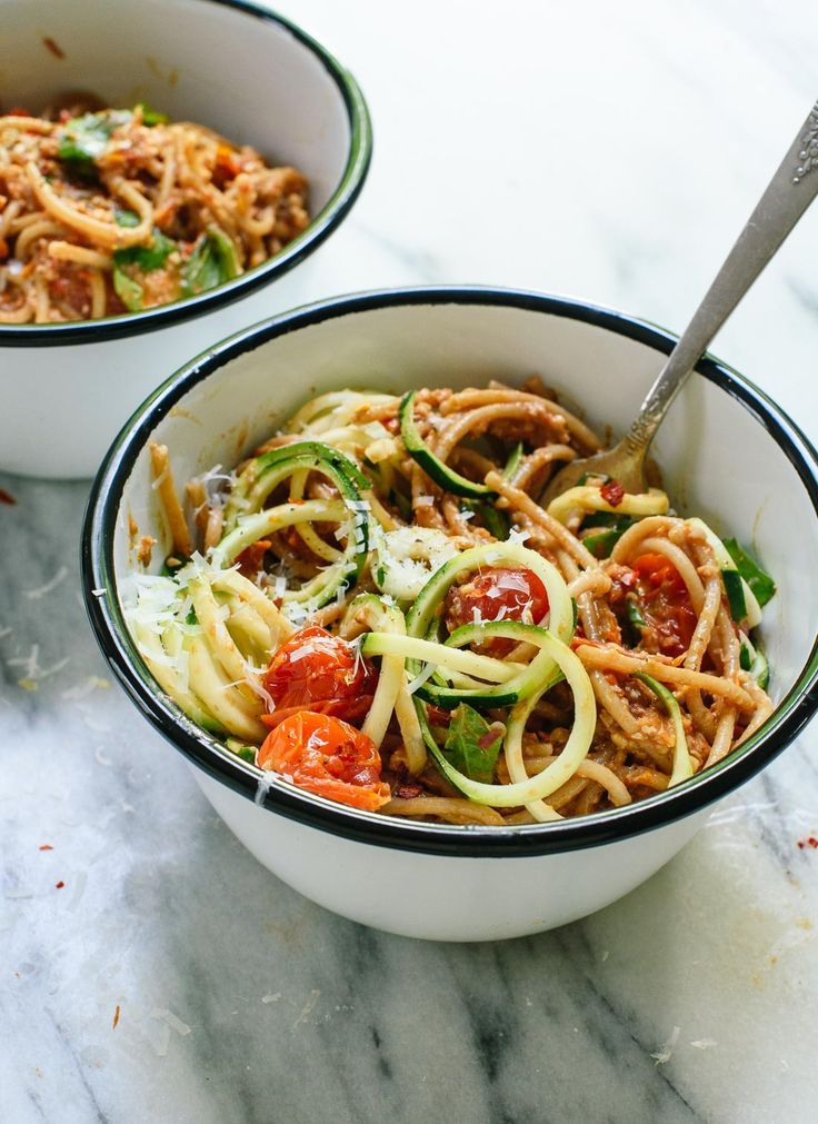 This fresh summer recipe features cherry tomato and sun-dried tomato pesto, zucchini noodles, and spaghetti! It's light and delicious. http://cookieandkate.com