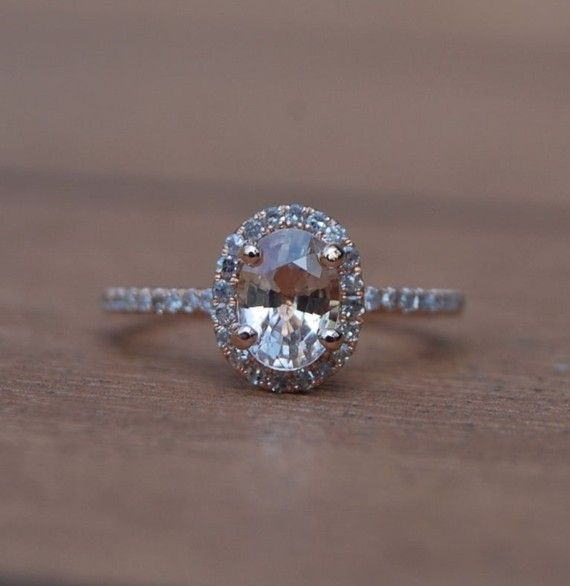 Love this peach sapphire engagement ring!