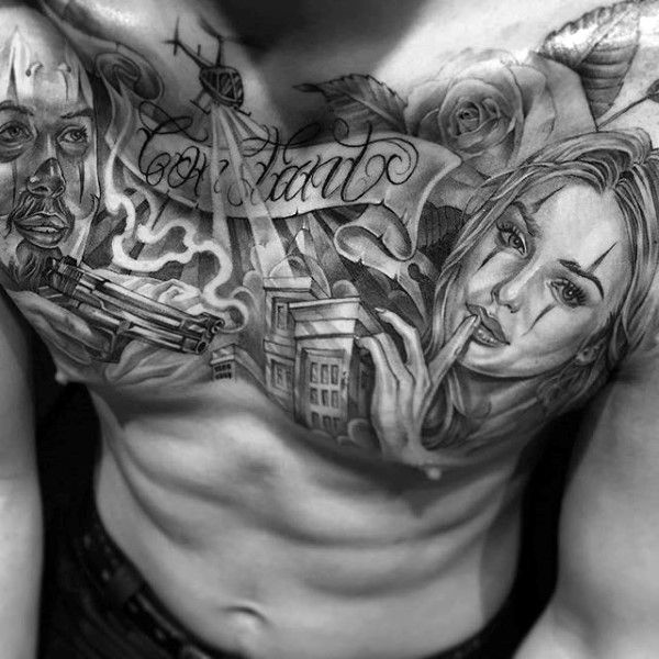 Male With Chicano Upper Chest Themed Tattoo Design