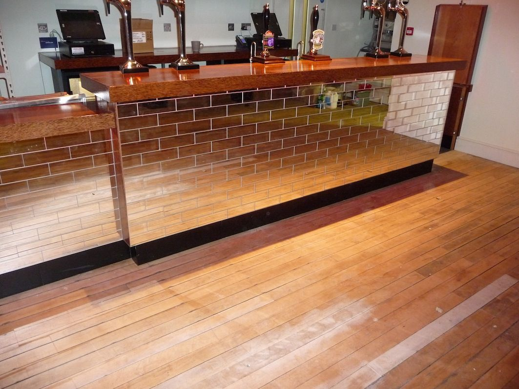 tile front? and either wood or concrete bar. | basement bar ideas