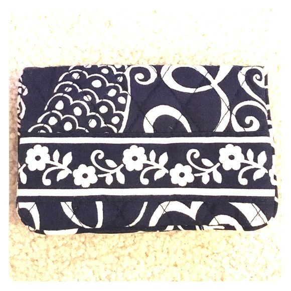 Blue and white Vera Bradley bi-fold wallet Store all your essentials in this compact wallet. Comes with a change purse, spot for your ID and other cards and a hook for your keys! Vera Bradley Bags Wallets
