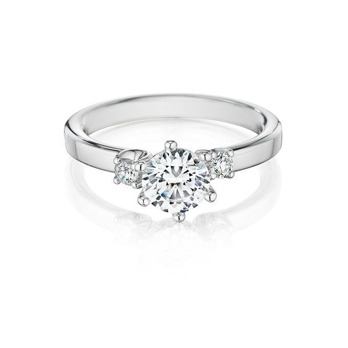Brides: Christian Bauer. Style 143169, 18K white gold three-stone engagement ring with 1ct center diamond with 2 side diamonds 0.13 total carat weight, price upon request, Christian Bauer