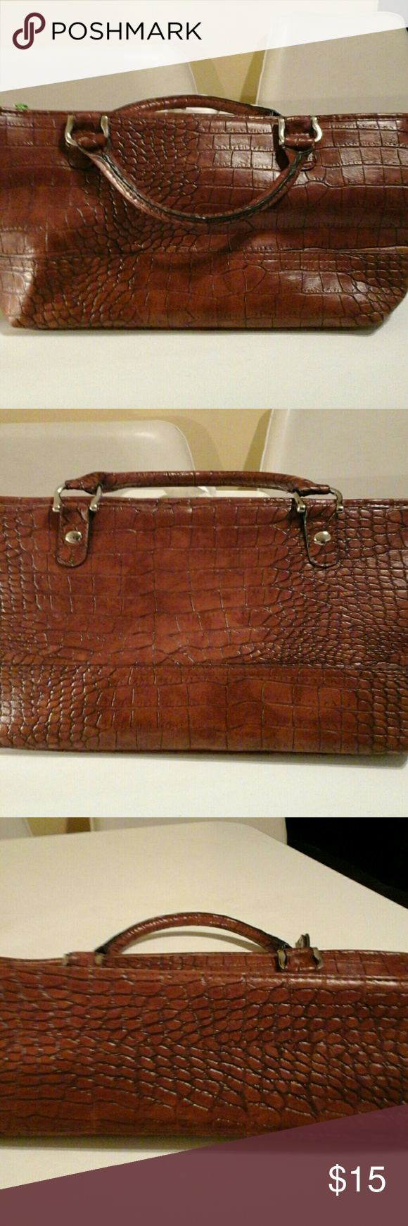 A BUENO BAG It is man made with the look of genuine leather.  It has a beautiful sheen, is lightweight, can hold quite a bit, and has a cross body strap.  Looks brand  new. Bueno Bag Bags Satchels