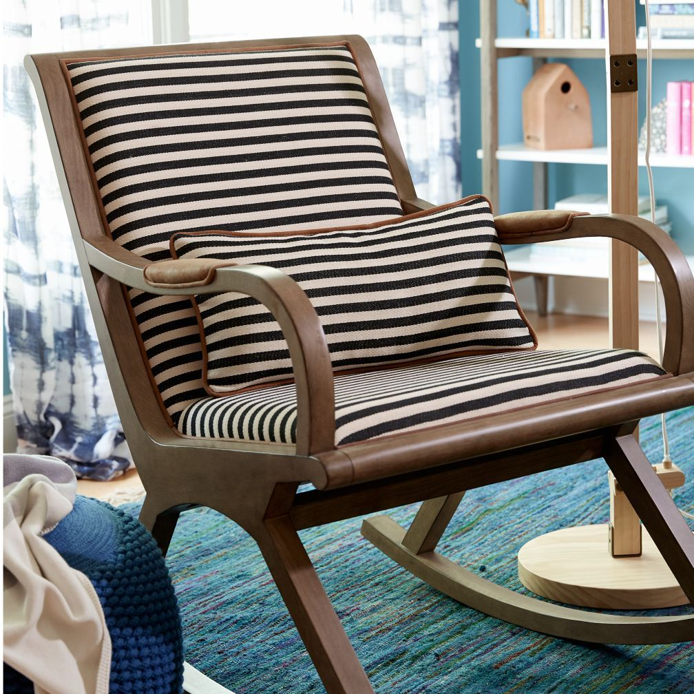 Love the chair - different fabric (greige seats black leather on arms?) or cowhide