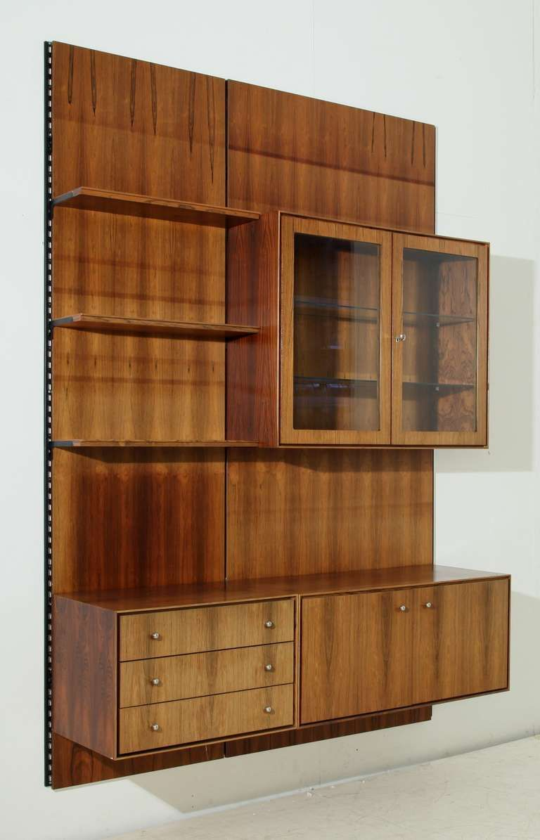 Anonymous; Rosewood, Glass And Brass Wall Mounted Storage Unit, 1950s.