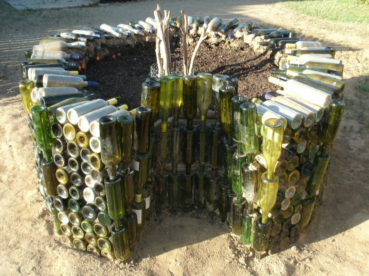 Using wine bottles to build a keyhole garden hmm good for How to use wine bottles in the garden