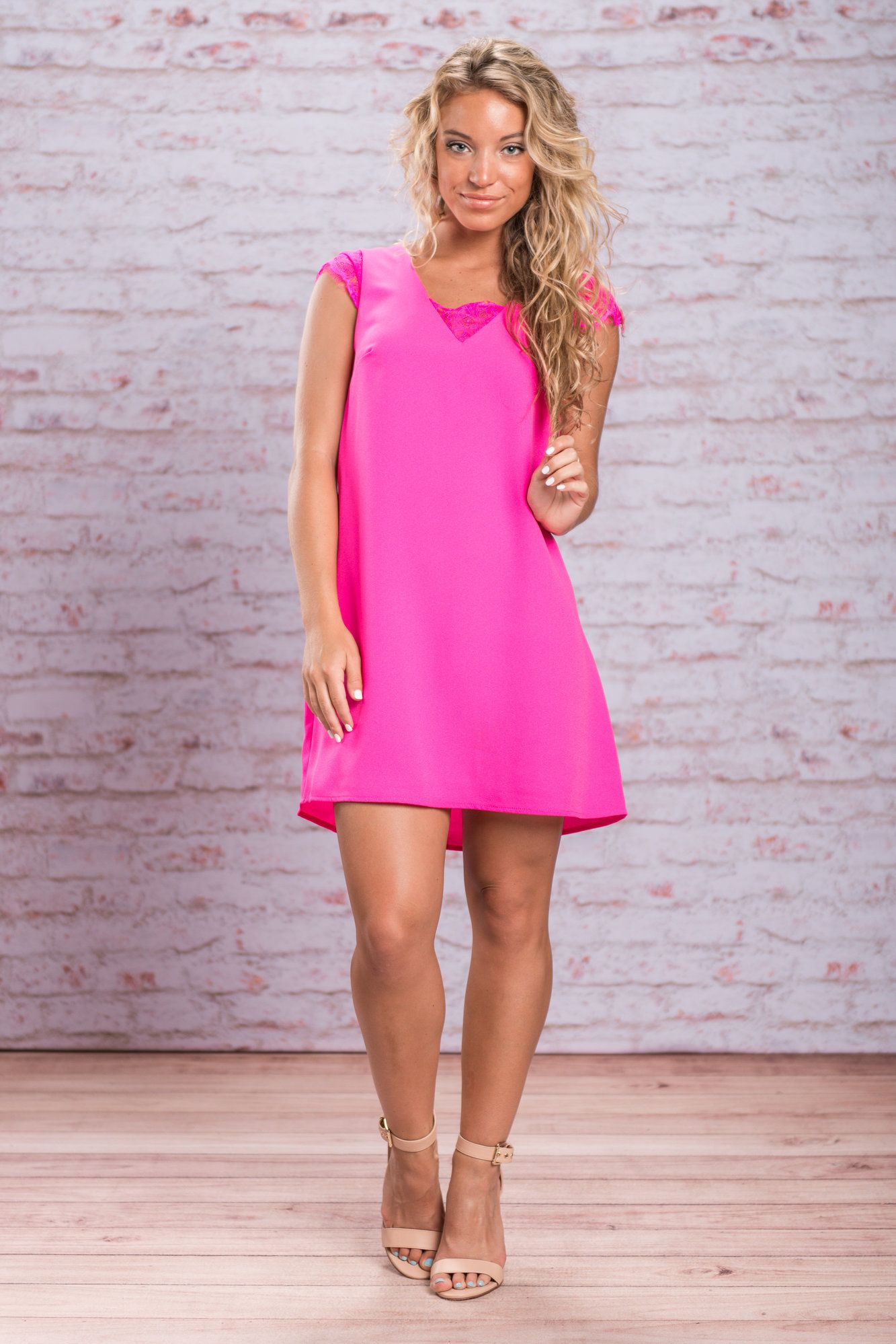 You will certainly feel famous and you will definitely be on fire! This dress hot hot hot! The hot pink color is stunning! But then again so is the classy cut and hit of sexy lace!  Material has no amount of stretch. Judith is wearing the small. Sizes fit: Small- 0-4; Medium- 6; Large- 8-10