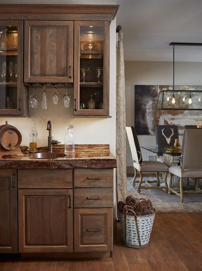 Warm Rustic Home Bar With Dark Wooden Cabinets Reclaimed Wood Countertops Brass Hardware And