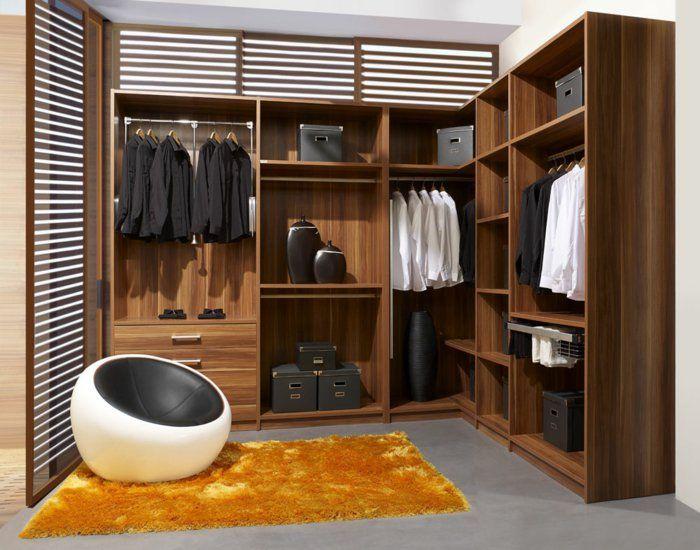 eckkleiderschrank design oranger teppich ausgefallener sessel ...