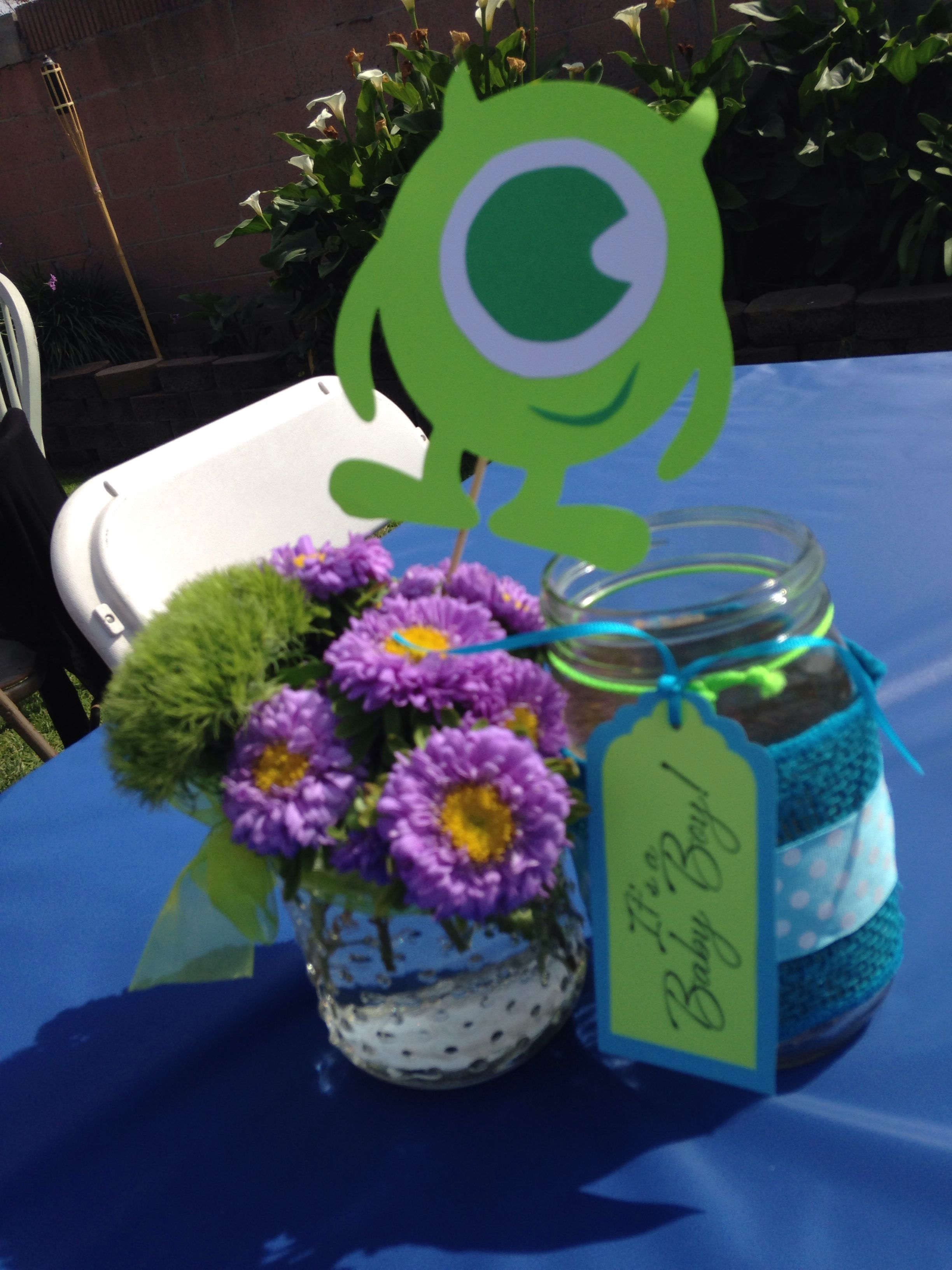 Monsters Inc baby shower centerpiece Wild flowers mason jars