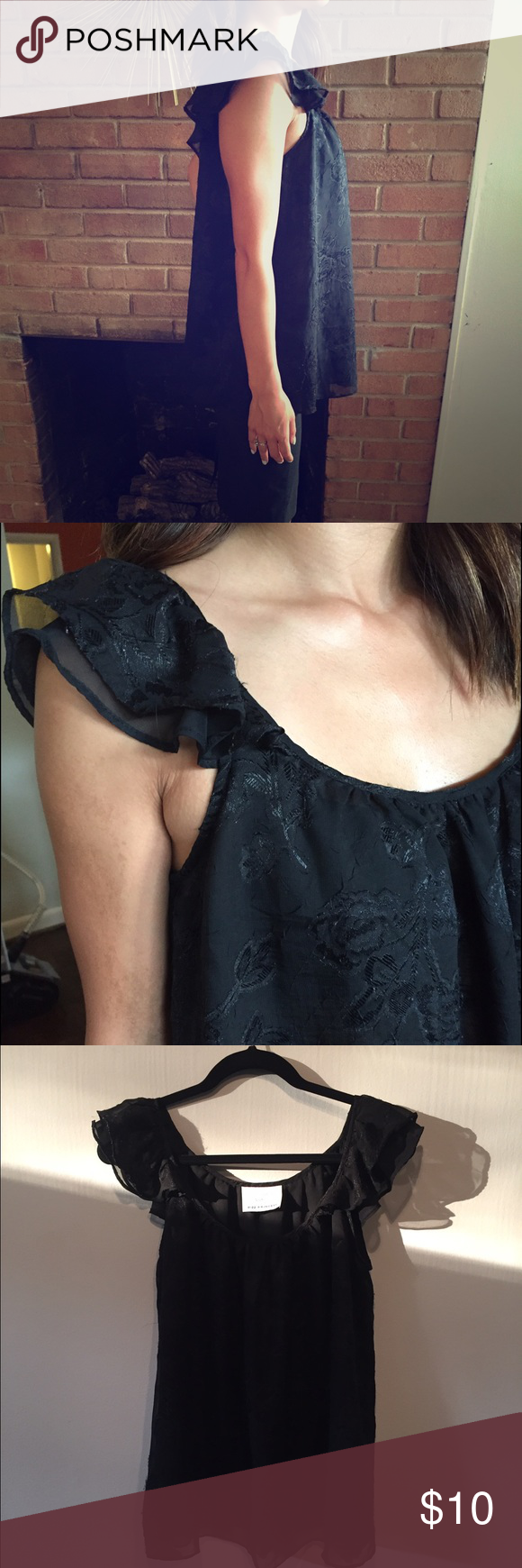 Boutique Floral Black Top Beautiful flower embroidered flowy top. You can dress it up or down. The fabric is slightly pilled, but it works for the style. You don't have to wear a tank underneath it since it has another layer underneath. Tops Blouses
