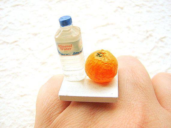 Anillo Agua mineral y naranja, $12.50