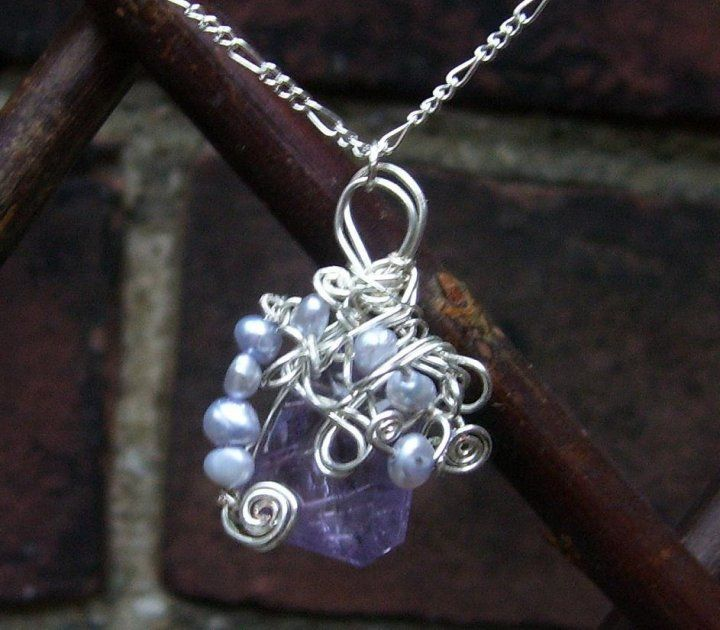 """""""Won't Somebody Please Think of the Mome Raths"""" pendant in amethyst, pearl, and silver plate."""