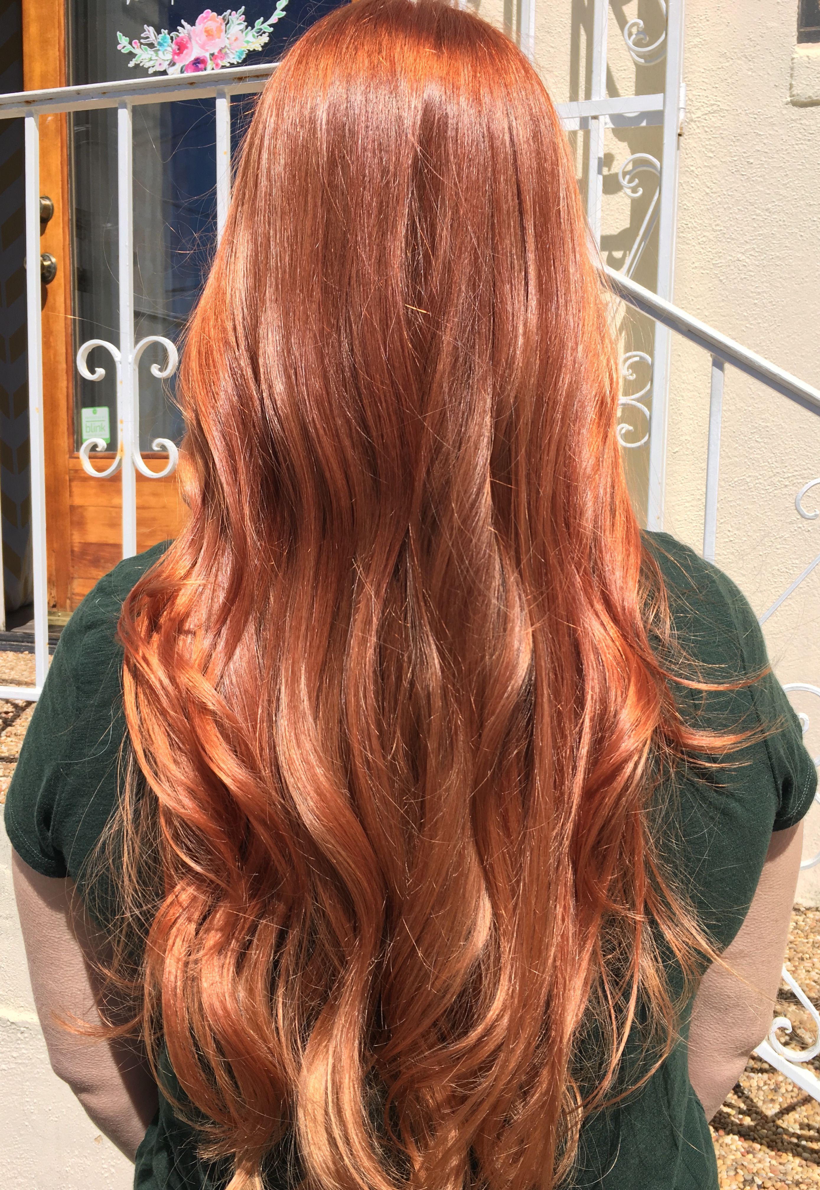 Copper red gold blonde balayage with rosegold in sunlight outdoor