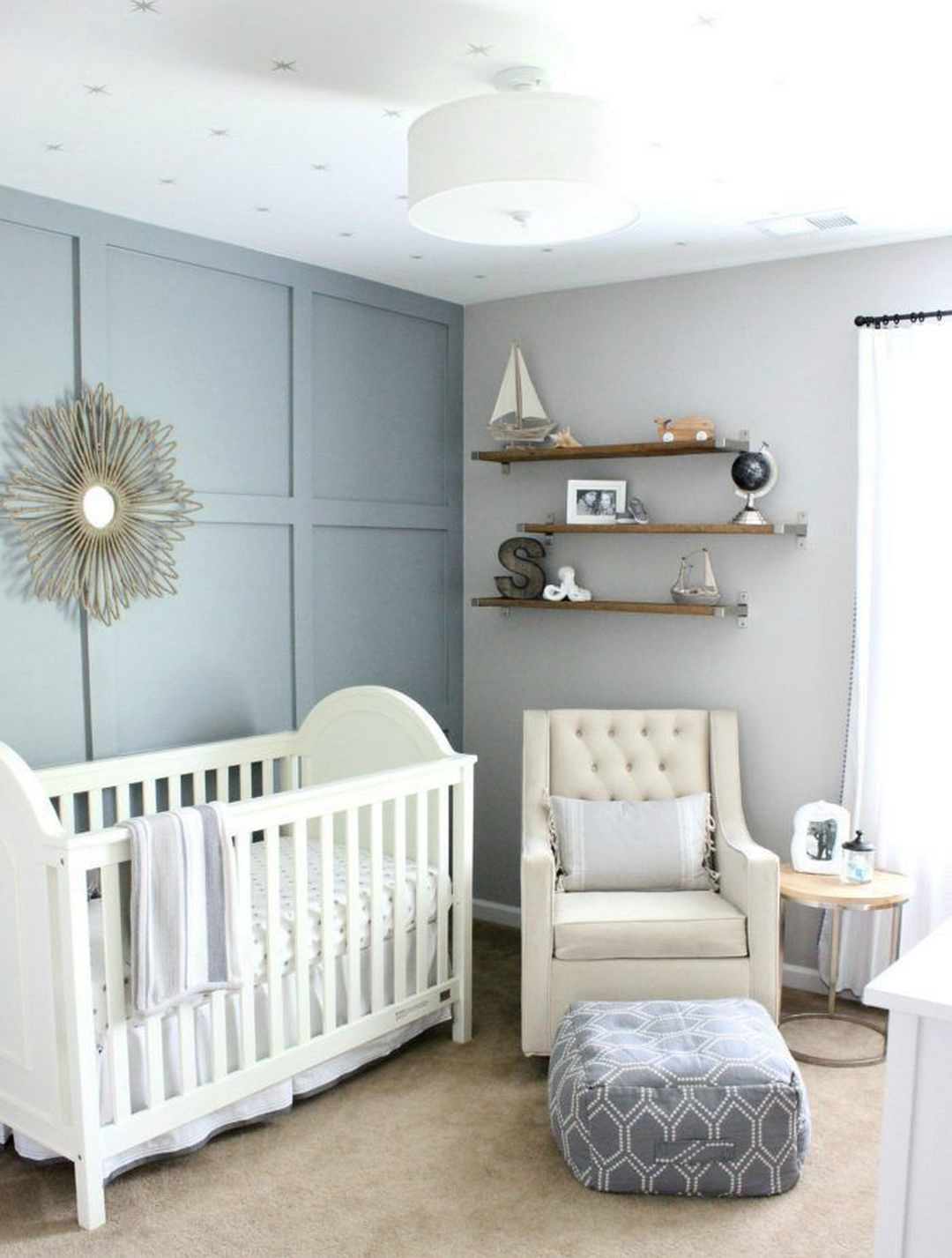 A Travel Nursery That Combines Both Nautical Inspired Elements Using Muted Shades Of Blue And Gray Natural Wood Tones Mixed Metals