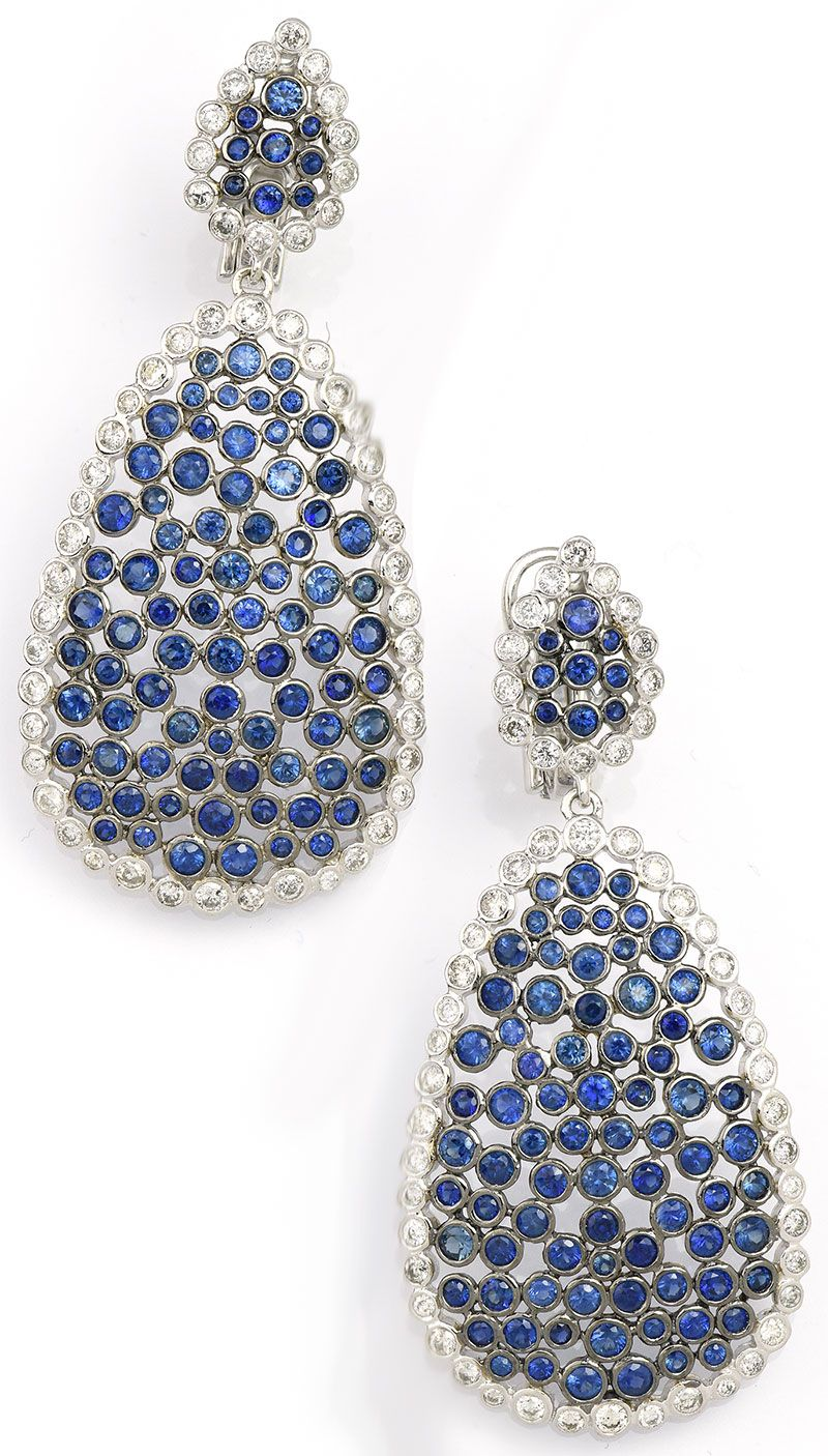 Make a statement in these Blue Sapphire Dangle Earrings in White Gold. Item #355-1416116 6.80 ct Blue Sapphire Round & 2.30 ctw Diamond Round 14K White & Black Rhodium Gold Dangle Earrings