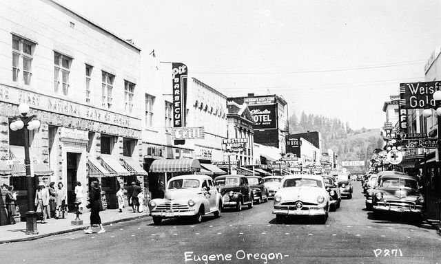 Downtown Eugene With Cars Lined Up At A Stop Circa 1955 Eugene