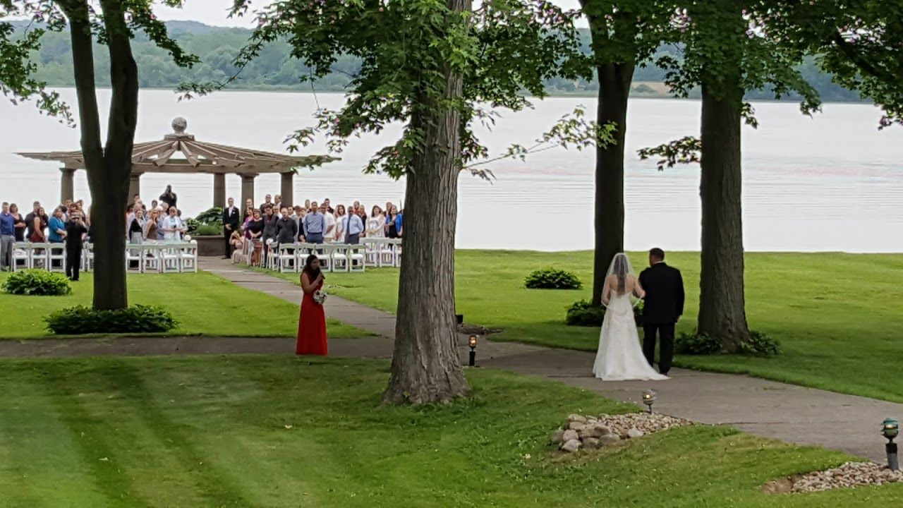 outdoor wedding ceremony sites in akron ohio%0A Bride and groom with a live singer during the procession at The Oaks  Lakeside Restaurant and    Lakeside RestaurantWedding CeremoniesWedding  VenuesThe