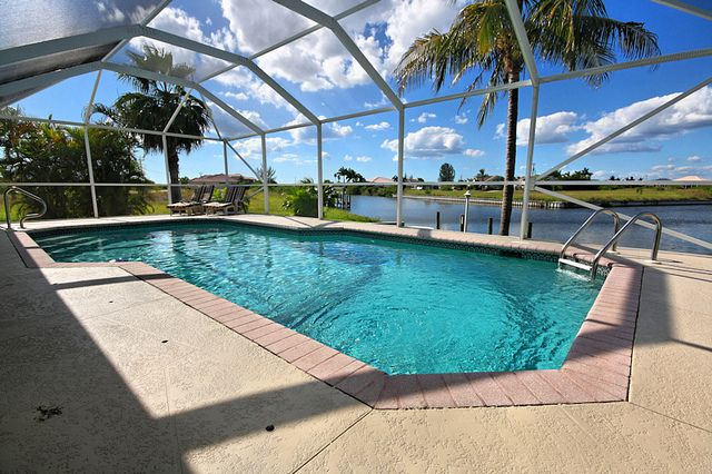Pool by signature florida homes a pool off the back with for Pool design naples fl