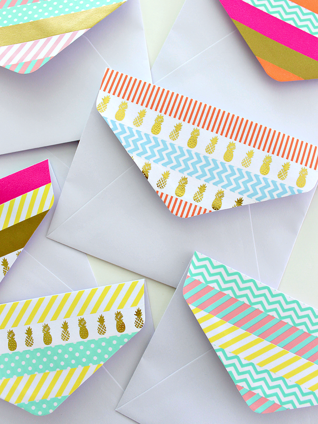 Decorate the flap of a boring white envelope with washi tape ...