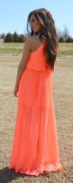 Sleeveless neon coral maxi dress with gold accented halter neckline -- & gorgeous pleated skirt. - Short lined slip underneath. Lined top. - Claps in back. Elas