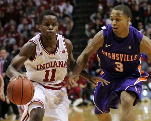 Indiana Hoosiers Guard Yogi Ferrell 11 Dribbles The Ball With Evansville Purple Aces Guard Jaylon Brown 3 Defending D Iu Hoosiers Indiana Hoosiers Hoosiers