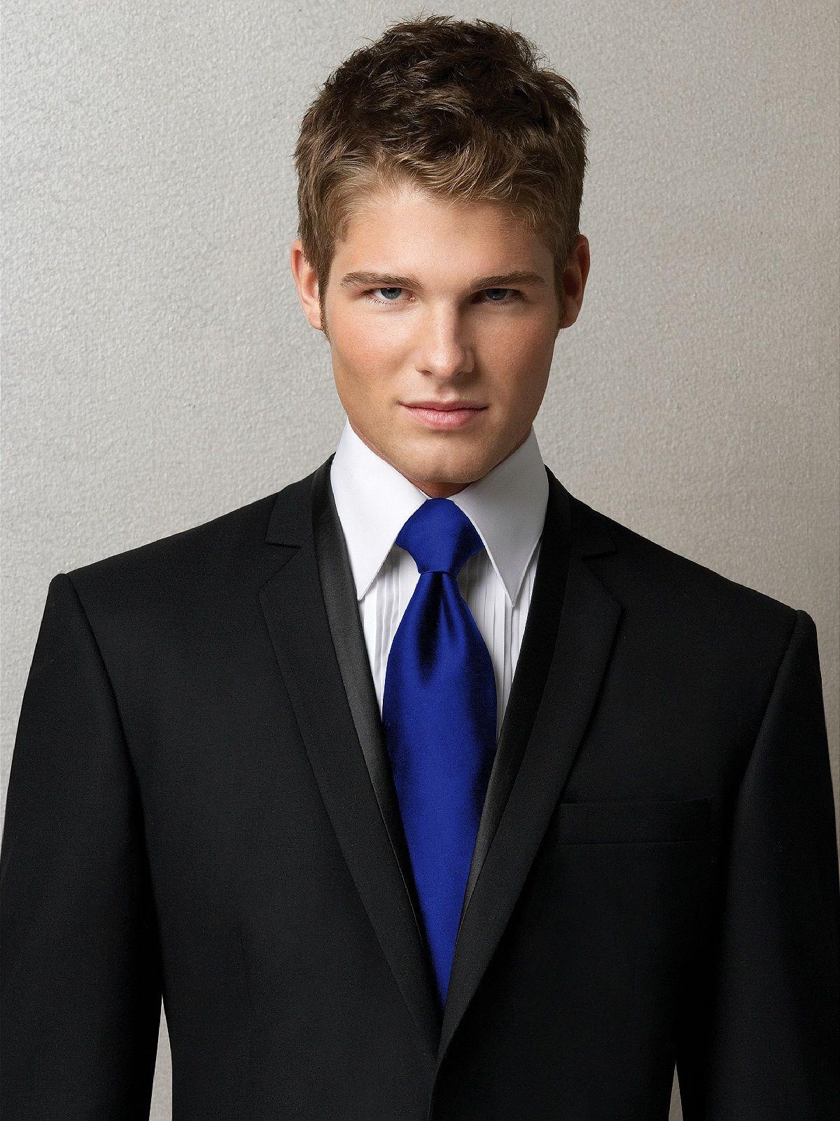 Black suit, royal blue tie. instead of black suit a white suit ...