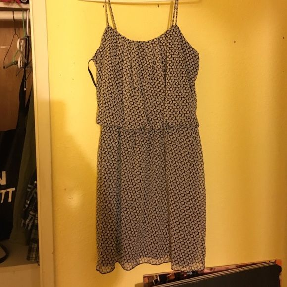 dark blue floral sundress worn once, really cute floral print dress with ruffle puff thing! size large but fits like a medium-large **NOT UO Urban Outfitters Dresses
