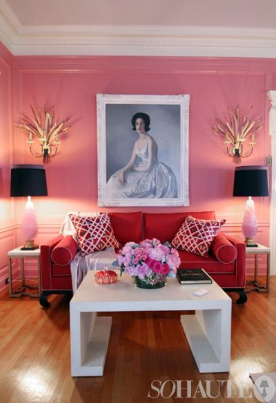 hot pink walls, red sofa, white coffee table, contrasting portrait ...