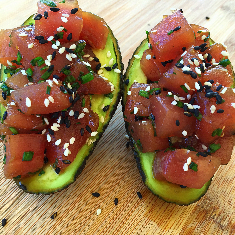 Fresh hawaiian ahi tuna poke stuffed avocados with spicy