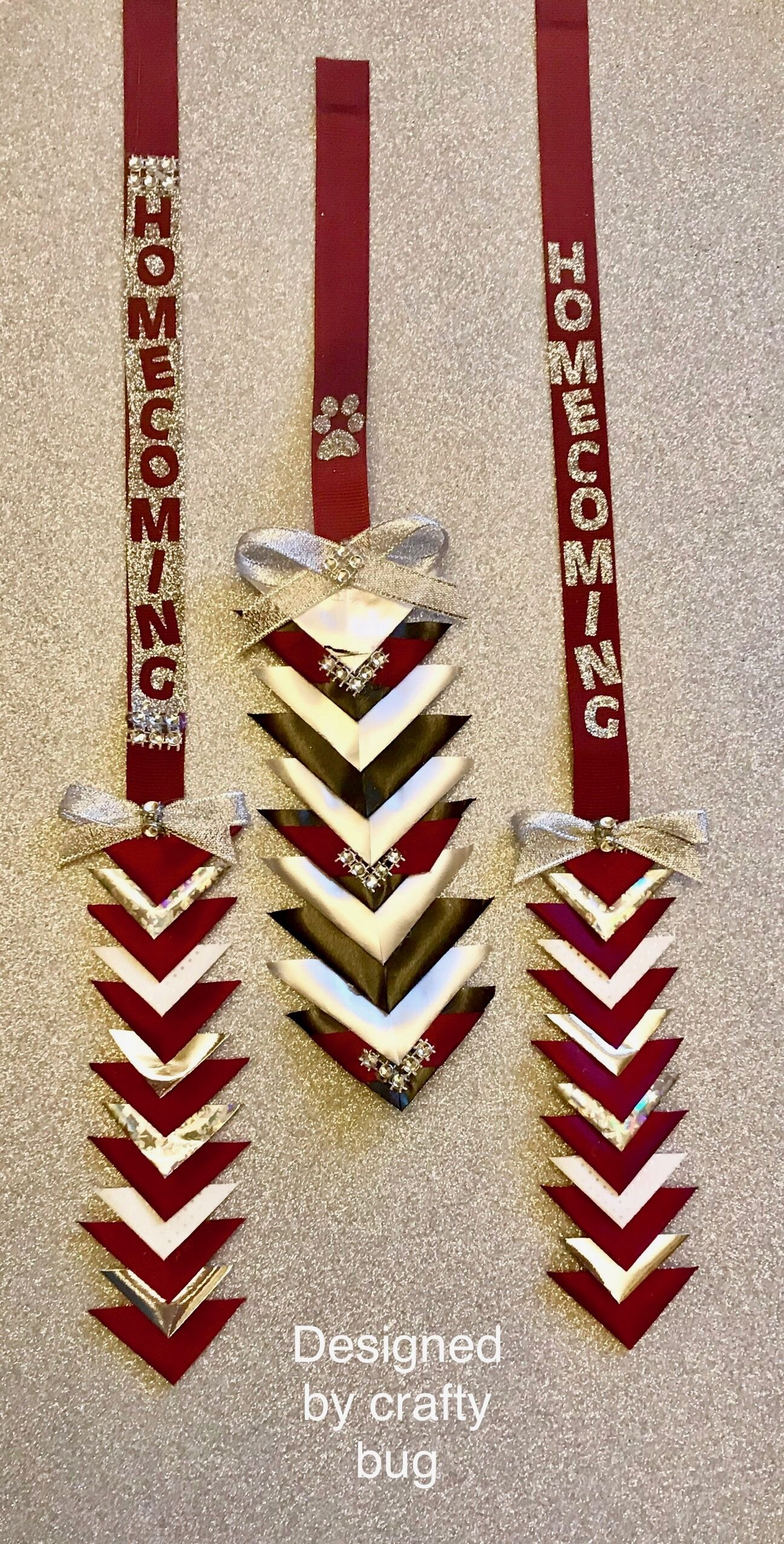 Maroon/ burgundy, white, black and silver triangular chains for homecoming mums.