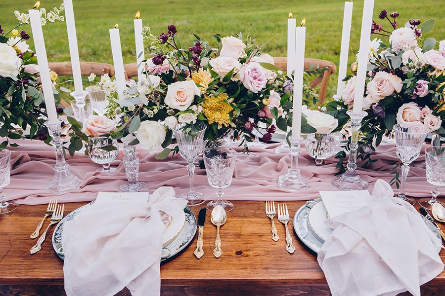 Beautiful compote centerpieces run down the entire length