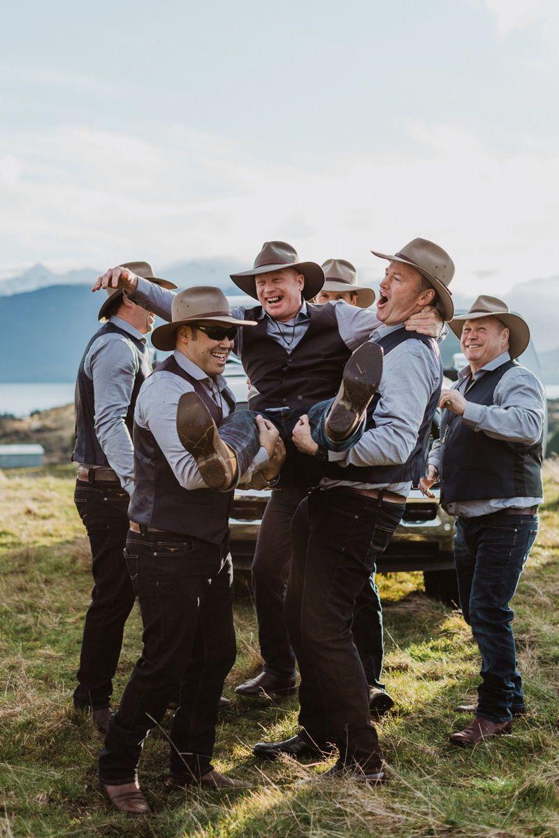 Groomsmen in akubra hats rustic winter wedding farm